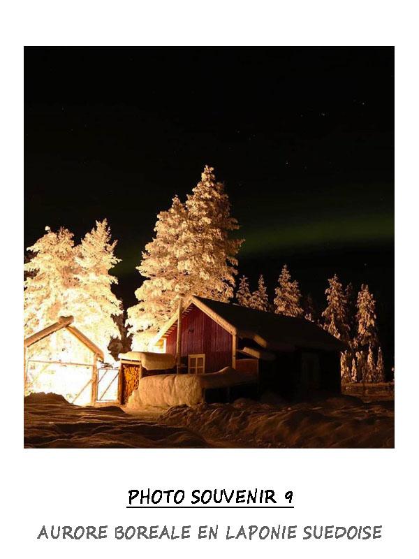 Aurore boréale au dessus du chenil en Laponie Suédoise